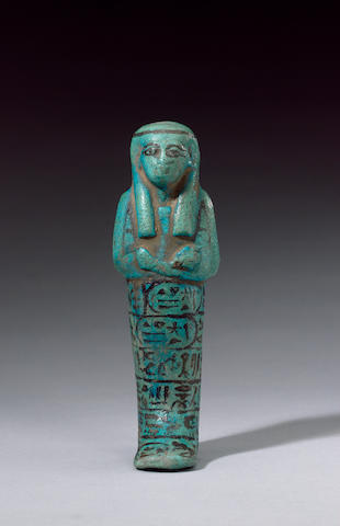 An Egyptian turquoise glazed composition worker shabti of the Divine Adoratrice Henttawy