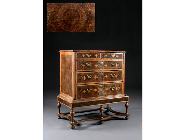 A fine late 17th century walnut and oyster-veneered chest on stand