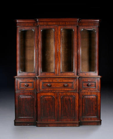 An early Victorian mahogany breakfront secretaire bookcase of small proportions,