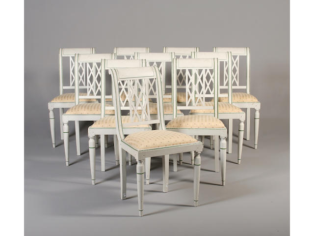 A set of ten Directoire style white painted dining chairs