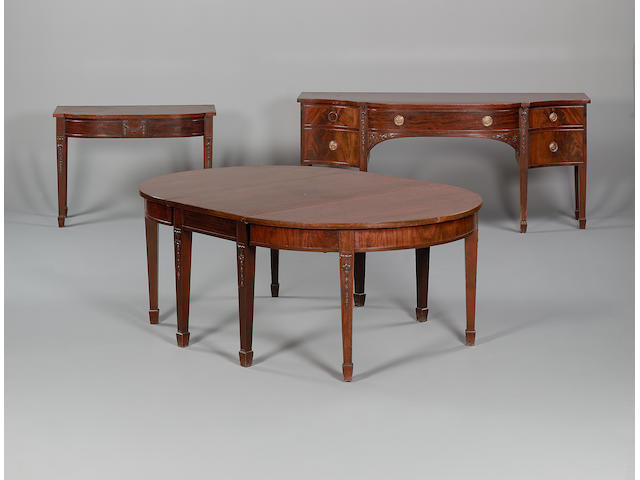 A late 19th century mahogany dining room suitein the George III style