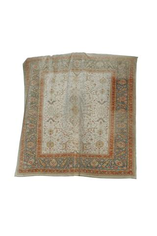 An Ushak carpet of unusual size circa 1950, 18 ft 3 in x 17 ft 8 in (556 x 539 cm)