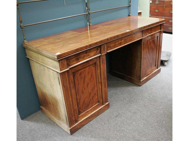 An Edwardian mahogany and boxwood strung pedestal sideboard