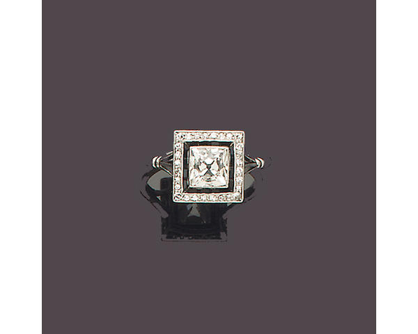 An art deco diamond and onyx ring,