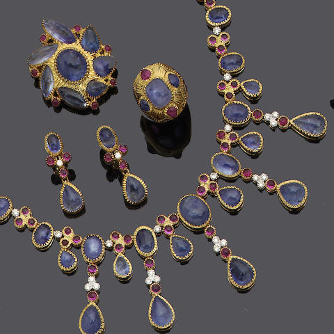 A sapphire, ruby and diamond necklace, brooch, ring and earring suite (4)
