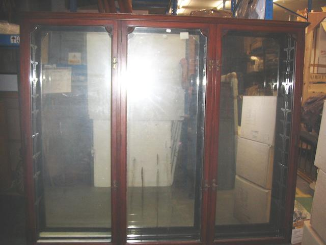 A large three door wooden display cabinet