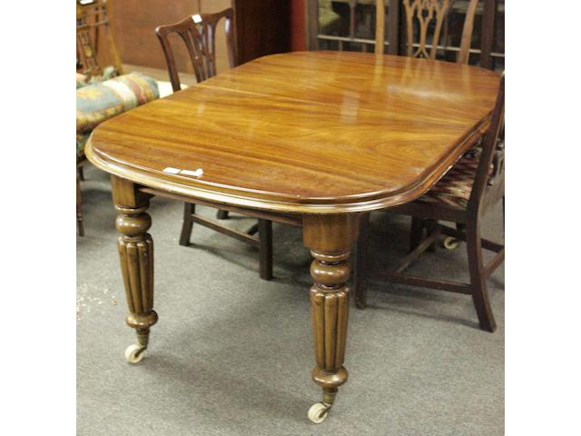 A mid Victorian mahogany extending dining table