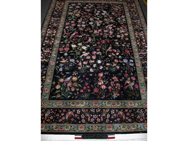 A part silk Tabriz rug North West Persia, 265cm x 157cm signed