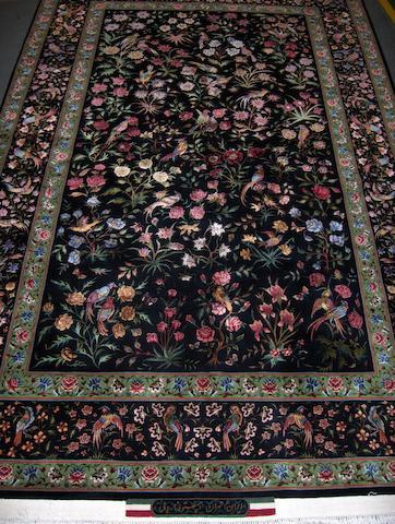 A part silk Tabriz rug North West Persia, 265cm x 157cm signed