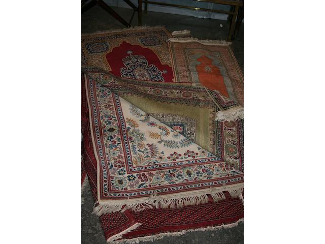 A collection of five decorative rugs