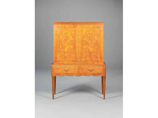 A Swedish marquetry cocktail cabinet designed 1950s