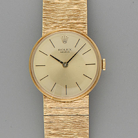 Rolex.  A lady's 9 carat gold wristwatch