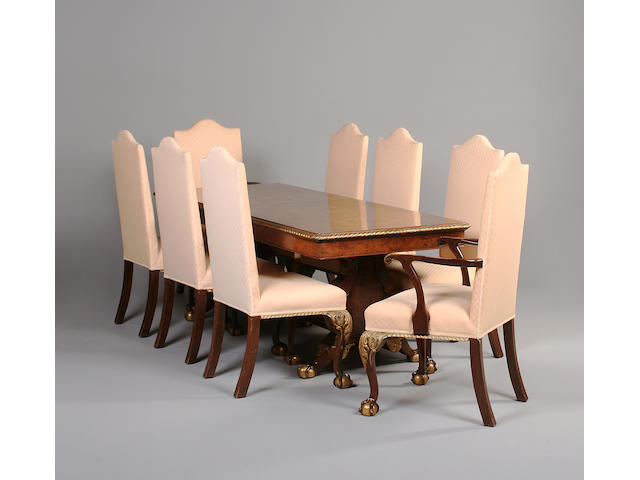 A George I style walnut and parcel gilt decoration dining suite