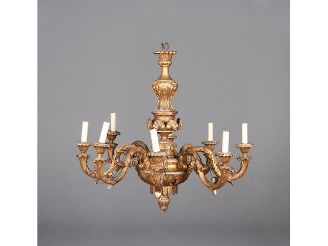 A large early 20th century Italian giltwood eight light chandelier