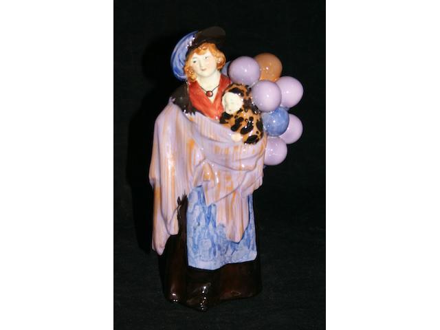 Figurines A Royal Doulton figure 'The Balloon Seller'