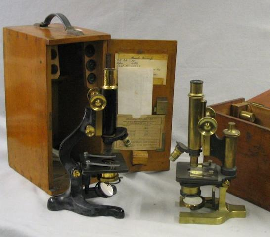Two cased microscopes,