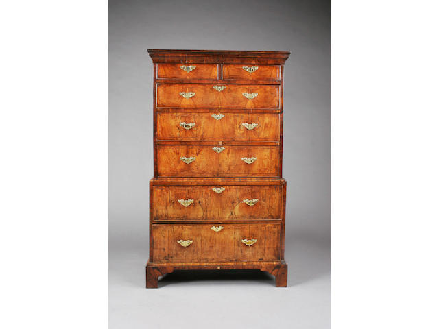 A small George I/early George II figured walnut and line inlaid chest-on-chest