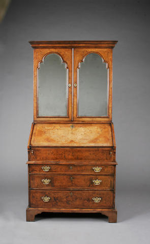 A George I burr and figured walnut, cross and feather banded bureau cabinet