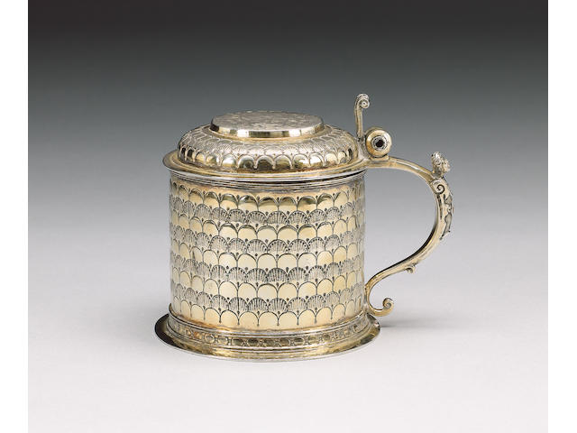 """A 17th century Continental silver gilt small tankard, one mark to base """"W"""", probably German,"""
