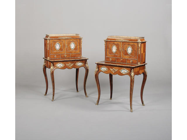 A pair of French late 19th/early 20th century kingwood and gilt metal mounted bonheur du jours