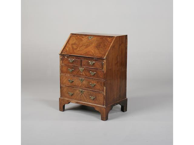 A late George II walnut bureau