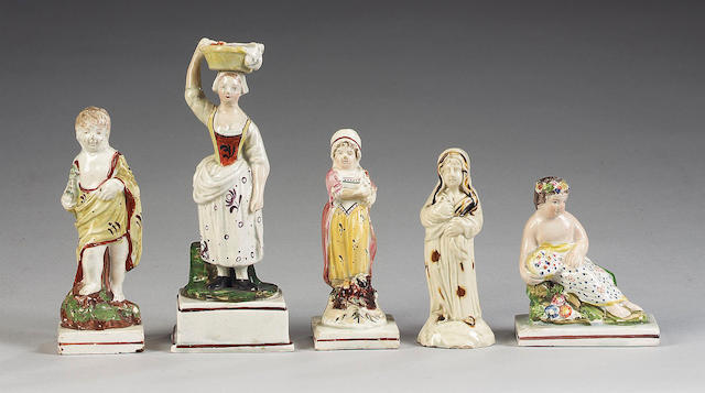 A pearlware figure of 'Winter', circa 1780 and four pearlware figures, circa 1810-20,