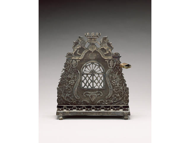 "A Continental silver Hanukah lamp, stamped ""12"" on backplate and rectangular base,"