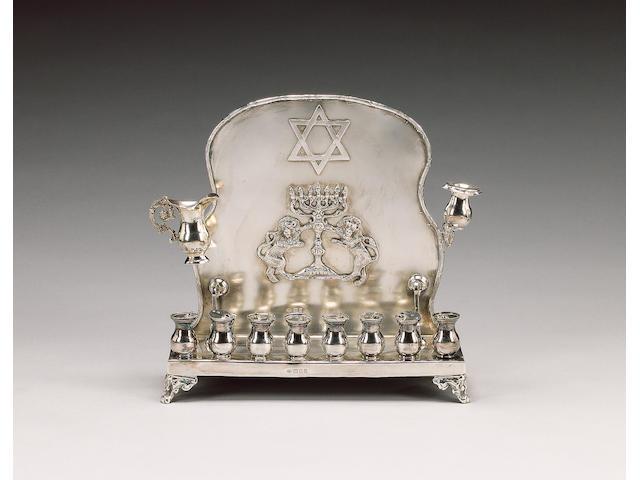 A silver Hanukah lamp, by Jacob Rosenzweig, London 1922,