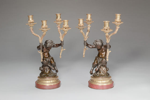 Pair of late C19th patinated bronze figural candelabra in the manner of Clodion on rouge marbe base
