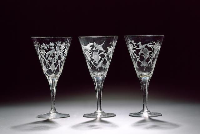 A set of eighteen fine Bohemian engraved wine glasses circa 1920