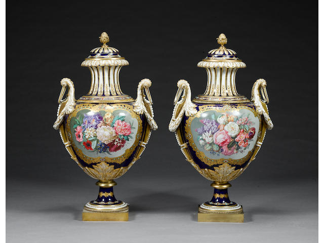 A magnificent pair of Sevres-style vases and covers