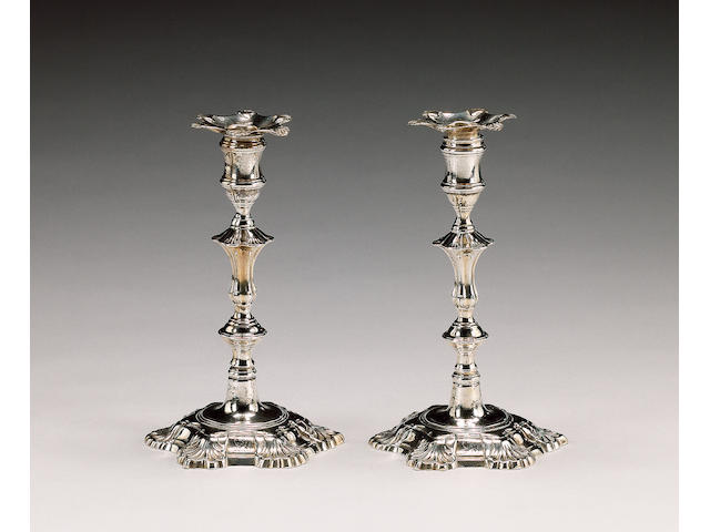 A pair of George II cast silver candlesticks, by John Cafe, London 1749, nozzles unmarked,