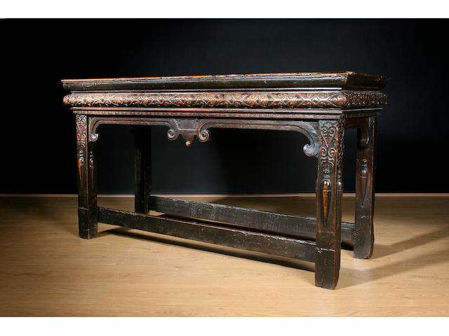 A rare early 17th Century walnut side table