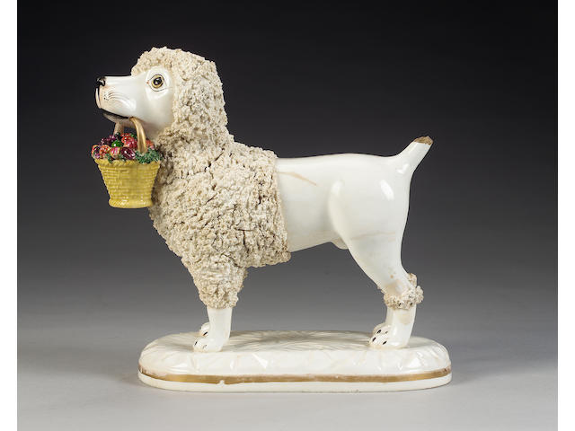 An important John and Rebecca Lloyd of Shelton model of a poodle with basket of fruit in its mouth,
