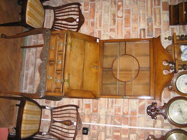 An unusual small oak bureau cabinet,
