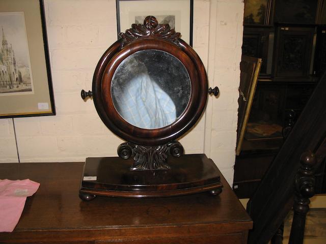 An early 19th Century mahogany toilet mirror,