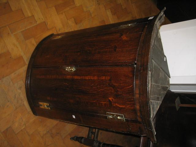 A George III oak bowfront corner cupboard,