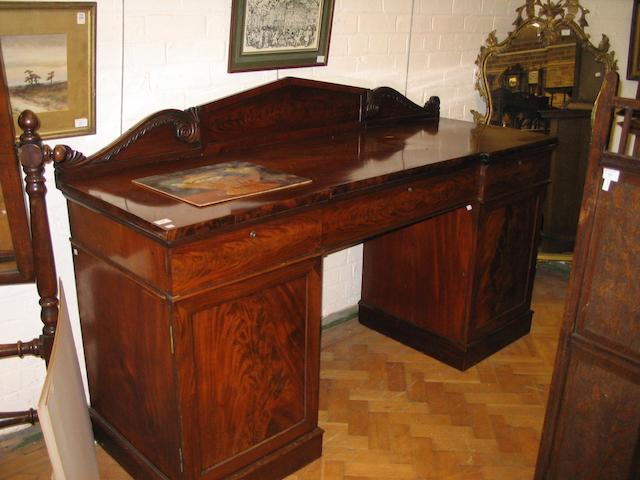 A Regency mahogany breakfront pedestal sideboard,