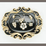 A Victorian black enamel memorial brooch