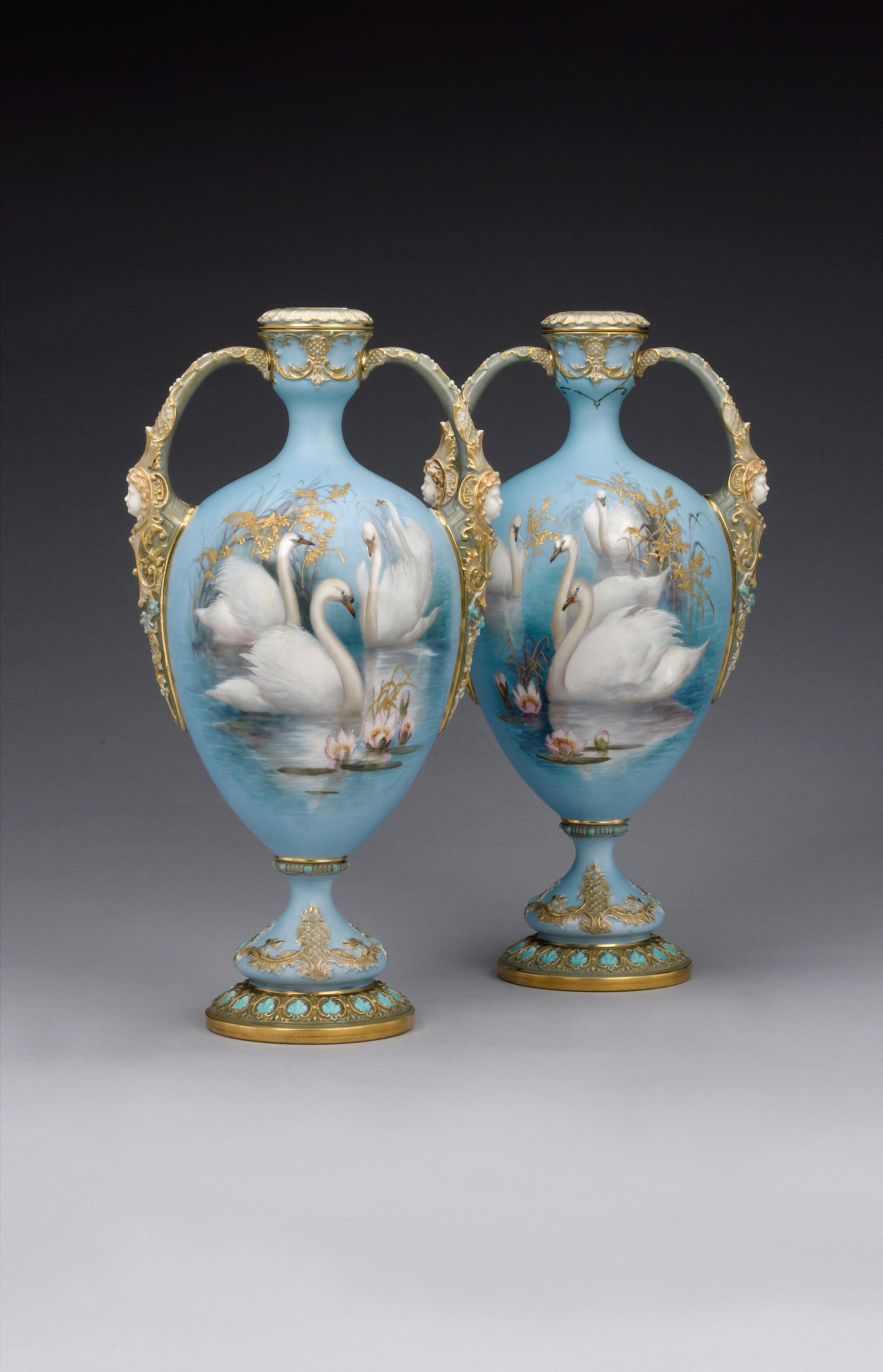 A rare pair of Royal Worcester vases and covers by Charley Baldwyn