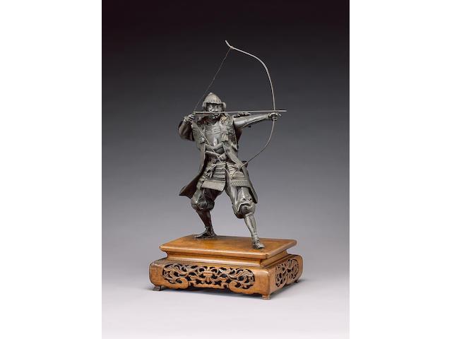 A bronze okimono of a standing Samurai,