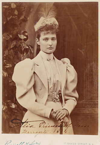 Alix, Princess of Hesse (1872-1918), later Alexandra-Feodorovna, last Empress of Russia A photograph of the Princess, mounted on photographer's card ('J. Russell & Sons, Portman Sq., London') signed at the bottom in pen 'Alix Princess of Hesse. Harrogate. 1894.' 15.8 x 11 cm. (6 ¼ x 4 3/8 in.)