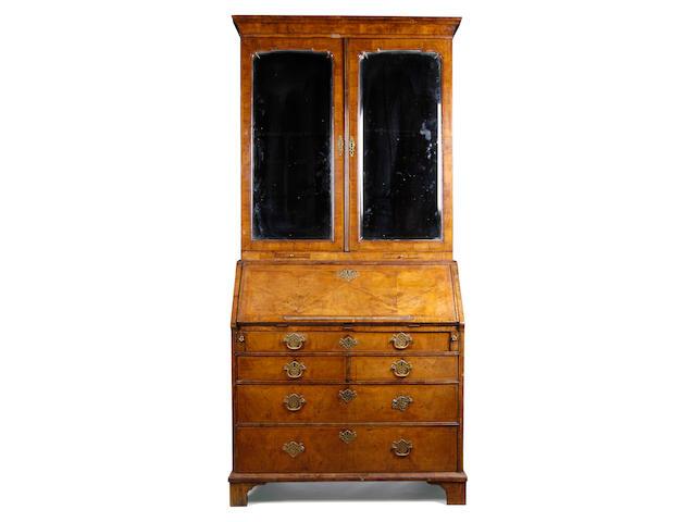 A George I walnut crossbanded and featherbanded bureau bookcase,