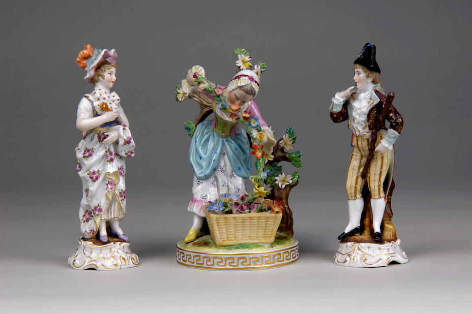 A pair of Sitzendorf porcelain figures