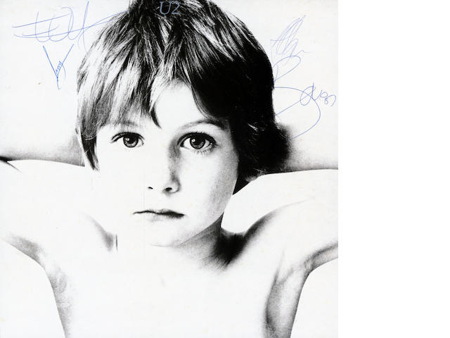 An autographed copy of the U2 album 'Boy',