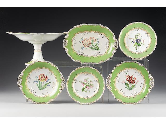 A Wedgwood earthenware botanical green ground dessert service, mid 19th century,