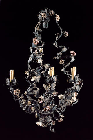 An early 20th century Continental painted tole peinte and porcelain mounted seven light chandelier 90cm drop