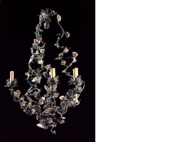 An early 20th century Continental painted tole peinte and porcelain mounted seven light chandelier 9