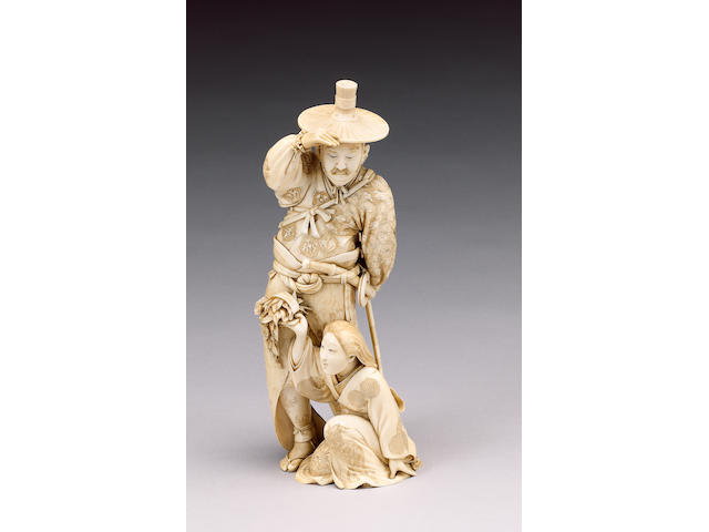 A fine stained ivory okimono of a Samurai,