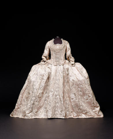 A rare and important Court Mantua and petticoat of ivory silk, French circa 1770